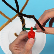 Hand craft an apple with pipe cleaners