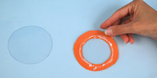 Use acetate and foam to create the lens to a telescope.