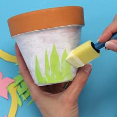 Decoupage shapes onto your flower pot