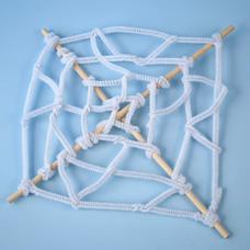 spiderweb made with fuzzy sticks
