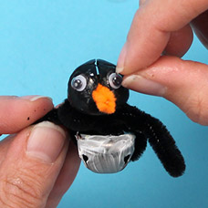 How to make a jingle bell penguin ornament with kids