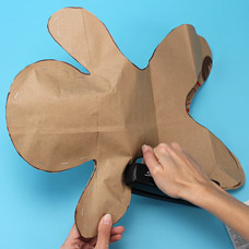 Make a gingerbread man art project with recycled paper bags