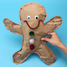 How to make a recycled paper bag gingerbread man