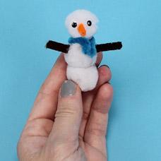 make a snowman out of pom poms